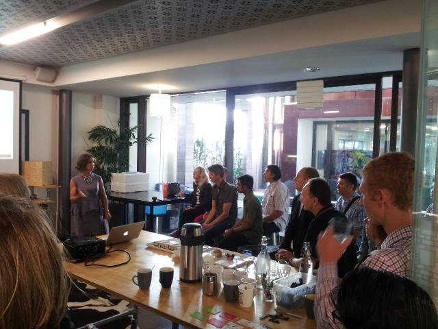 Rebecca Caroe of Creative Agency Secrets presenting at a marketing breakfast.