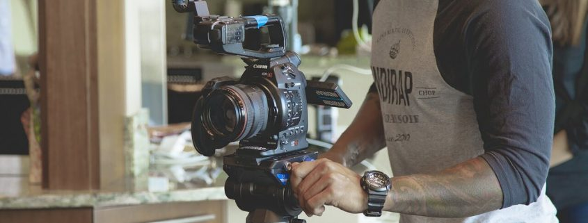 Cameraman holding a video camera