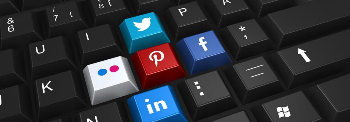 Social media logos on keyboard